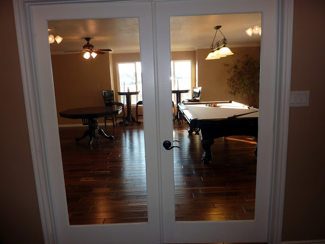 French doors leading to billiard room